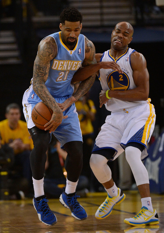 . OAKLAND, CA - APRIL 28:Wilson Chandler (21) of the Denver Nuggets steals the ball from Jarrett Jack (2) of the Golden State Warriors during the first quarter in Game 3 of the first round NBA Playoffs April 28, 2013 at Oracle Arena. (Photo By John Leyba/The Denver Post)
