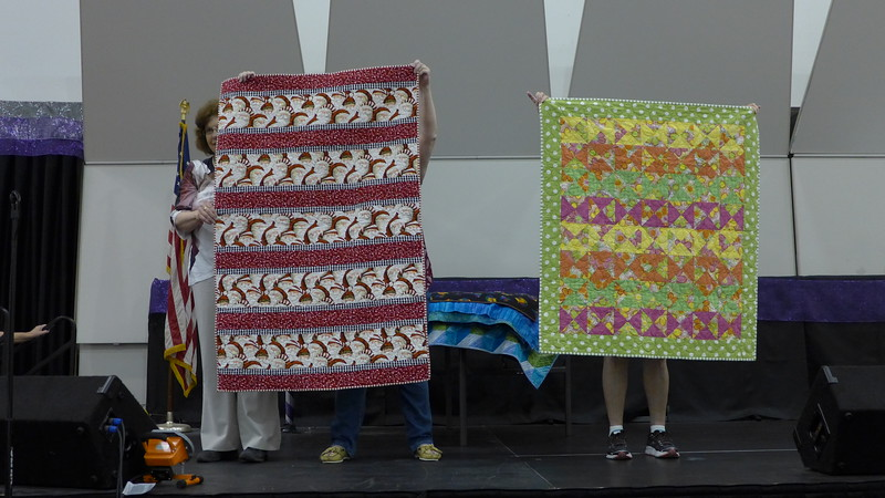 Jackie Beard reported that she started making more charity quilts since she retired.  They are destined for the Heartwarmers Project after the quilt show.