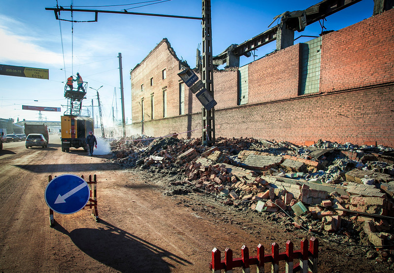 . Workers repair a power line near the wall of a local zinc plant which was damaged by a shockwave from a meteor in the Urals city of Chelyabinsk, on February 15, 2013. A meteor strike in central Russia that left today hundreds of people injured is the biggest known human toll from a space rock, a British expert said.  OLEG KARGOPOLOV/AFP/Getty Images