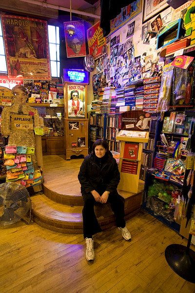 Darcie takes a breather in a magic shop in Pike Place Market.