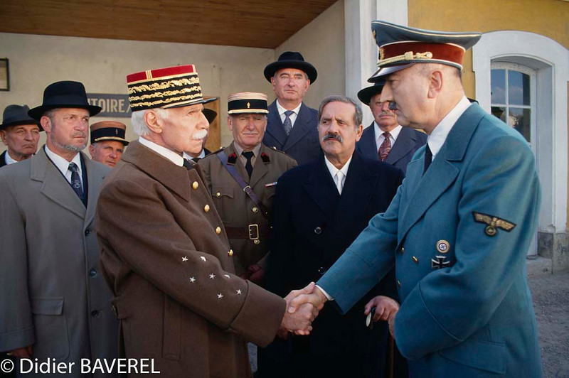 1992, France --- French actors Jacques Dufilho and Jean Yanne and German actor Ludwig Haas on the set of the film <Petain>, directed by Jean Marboeuf. --- Image by © Didier Baverel
