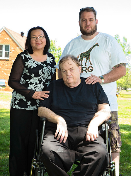 Groom with Stepmother and father outside.jpg