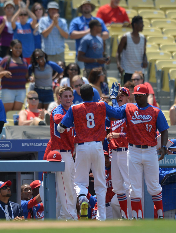 . Serra\'s Marcus Wilson (8) is welcomed to the dug out after Wilson hit a home run against Mira Costa in the CIF-SS Division III championship baseball game Friday at Dodger Stadium. Serra won the title, 8-1. 20130531 Photo by Steve McCrank / Staff Photographer