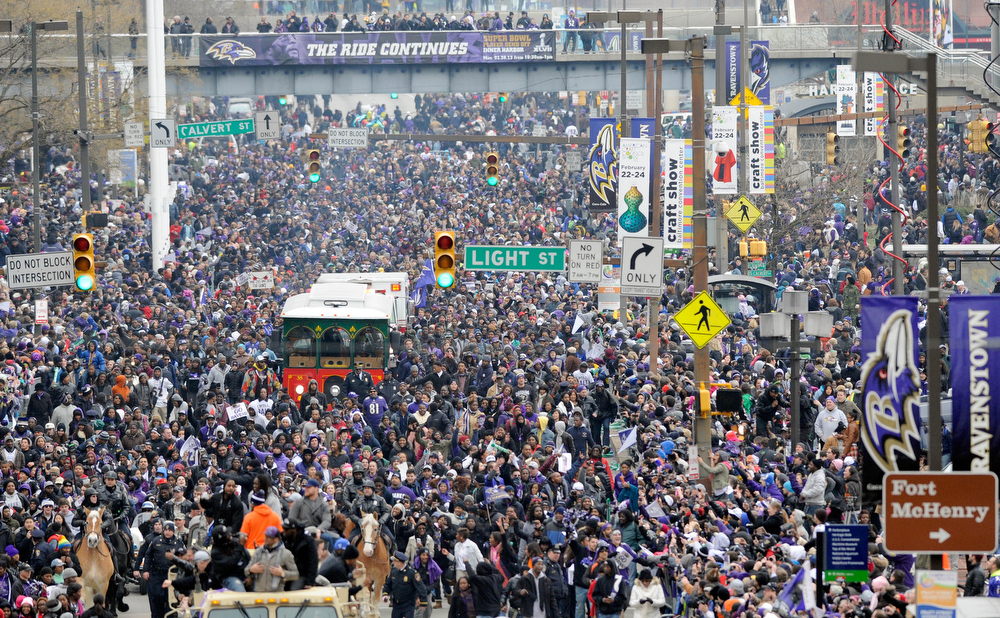 Description of . Baltimore Ravens fans fill the streets during a victory parade Tuesday, Feb. 5, 2013, in Baltimore. The Ravens defeated the San Francisco 49ers in NFL football's Super Bowl XLVII 34-31 on Sunday.(AP Photo/Steve Ruark)