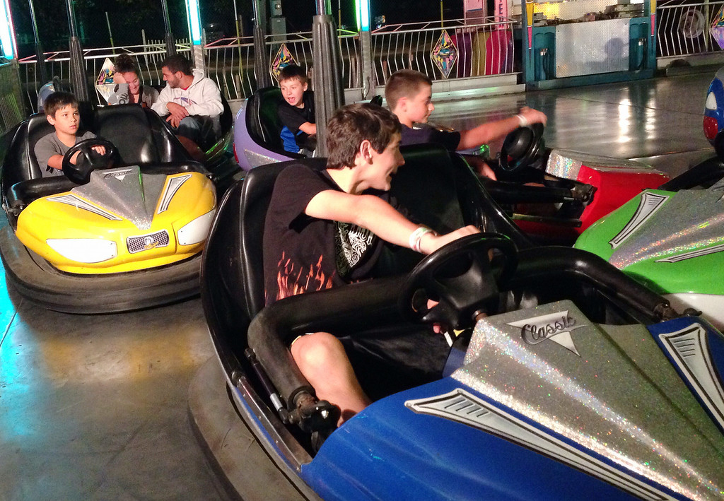 . Riders bump and slam as they ride the bumper cars of the midway  at the Boonville Oneida County Fair on Friday July 25, 2014. JOHN HAEGER-ONEIDA DAILY DISPATCH @ONEIDAPHOTO ON TWITTER