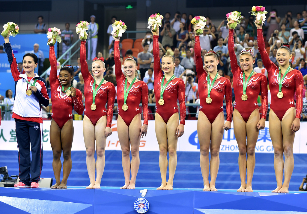 . US gymnasts celebrate their victory on the podium during the awards ceremony of the women\'s team final of the Gymnastics World Championships in Nanning, in China\'s southern Guangxi province on October 8, 2014.    AKAZUHIRO NOGI/AFP/Getty Images