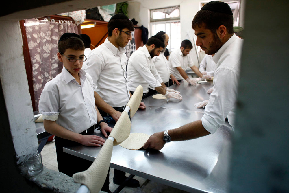 . Ultra-Orthodox Jewish youths prepare matza, a traditional unleavened bread, to be eaten during the upcoming Jewish holiday of Passover in Jerusalem March 21, 2013. Passover, which starts next week, commemorates the flight of Jews from ancient Egypt, as described in the Exodus chapter of the Bible. According to the account, the Jews did not have time to prepare leavened bread before fleeing to the promised land. REUTERS/Nir Elias
