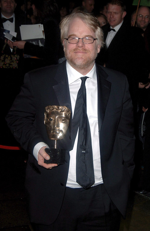 . A file picture dated 19 February 2006 shows US actor Philip Seymour Hoffman attending the BAFTA (British Academy of Film and Television Arts) Awards after-party at the Grosvenor House Hotel in London, Britain, carrying the \'best actor\' award he won.   According to reports on 02 February 2014, Philip Seymour Hoffman was found dead in his apartment in Manhattan, New York, USA. The cause of death has not been determined yet. He was 46.  EPA/DANIEL DEME