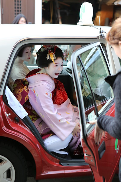 Geiko and Meiko speed away in a taxi