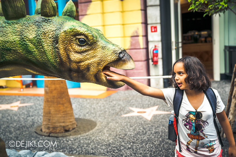Universal Studios Singapore Park Update - Jurassic World Explore and Roar event - Jurassic World park decor / Stegosaurus touching