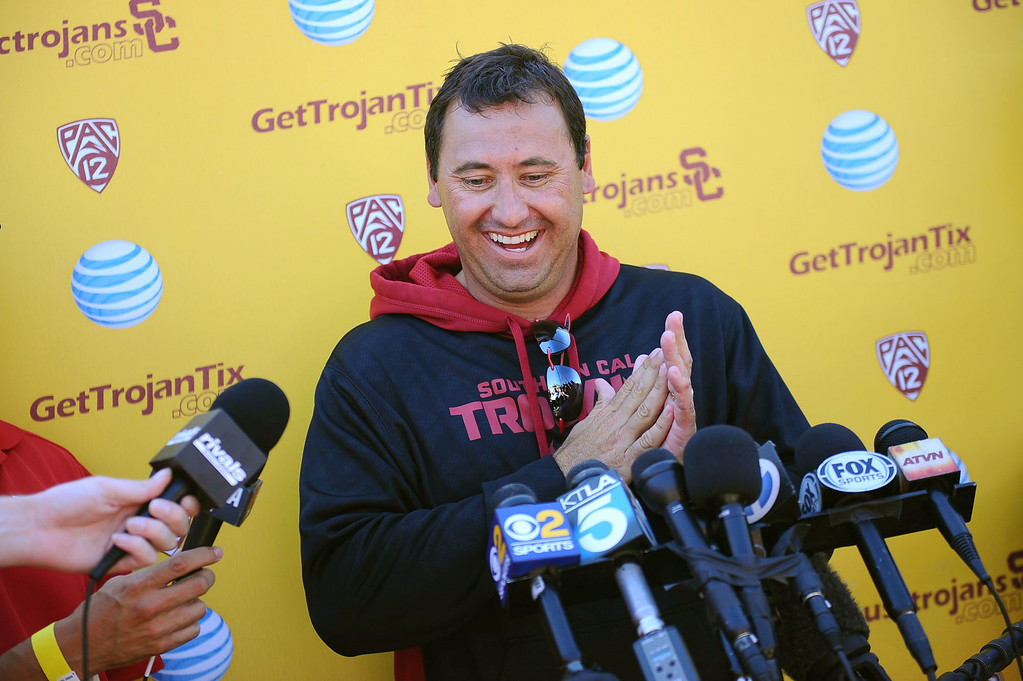 . USC head coach Steve Sarkisian fields questions from the media following practice on USC\'s Howard Jones Field August 27, 2014.(Andy Holzman/Daily News Staff Photographer)