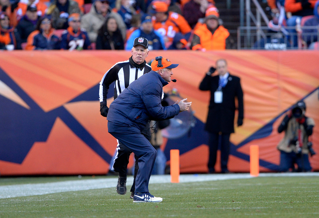. Denver Broncos head coach John Fox on the field during play as the referee asked him to return to the sidelines. The Denver Broncos vs. The San Diego Chargers in an AFC Divisional Playoff game at Sports Authority Field at Mile High in Denver on January 12, 2014. (Photo by Joe Amon/The Denver Post)