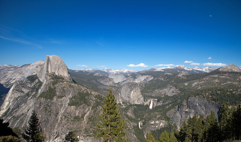 Half Dome, and the high country, as seen from Glacier Point..  Daytime moon upper right