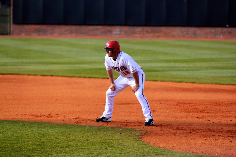 No. 18, Scott Coleman, gets a lead off of first base