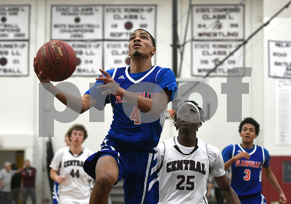 1/9/2018 Mike Orazzi | Staff Plainville's Jailen Lindsey (4) at BC Tuesday night.