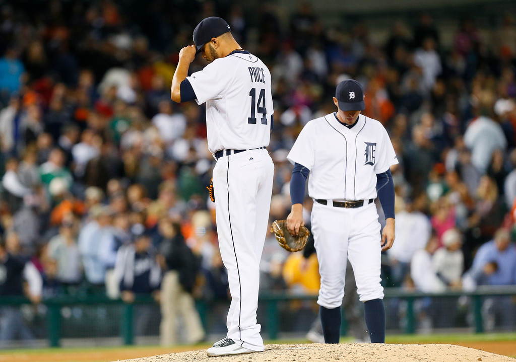 . Detroit Tigers pitcher David Price (14) reacts after allowing a Chicago White Sox\'s Marcus Semien one-run single in the ninth inning of a baseball game as third baseman Don Kelly approaches the mound in Detroit Tuesday, Sept. 23, 2014. (AP Photo/Paul Sancya)