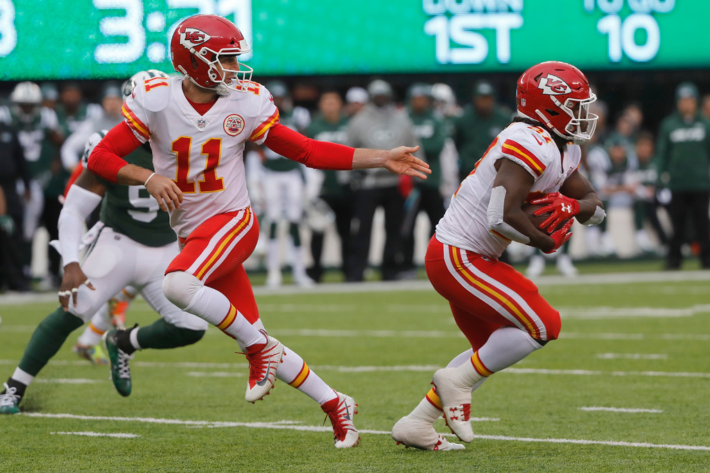 . Kansas City Chiefs quarterback Alex Smith, left, hands off to Kansas City Chiefs\' Kareem Hunt during the second half of an NFL football game, Sunday, Dec. 3, 2017, in East Rutherford, N.J. (AP Photo/Julie Jacobson)