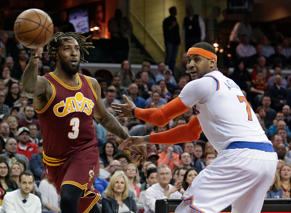 . Cleveland Cavaliers\' Derrick Williams (3) passes against New York Knicks\' Carmelo Anthony (7) in the first half of an NBA basketball game, Thursday, Feb. 23, 2017, in Cleveland. (AP Photo/Tony Dejak)
