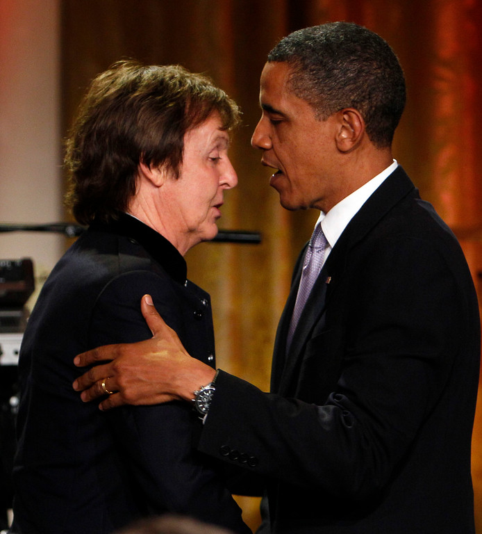 . President Barack Obama, right, embraces Paul McCartney before presenting him with the Gershwin Prize for Popular Song in the East Room of the White House in Washington Wednesday, June 2, 2010.(AP Photo/Alex Brandon)