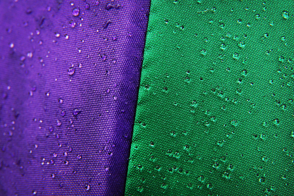 . LONDON, ENGLAND - JULY 02: Rain drops glisten on a Wimbledon branded umbrella at the Wimbledon Lawn Tennis Championships on July 2, 2013 in London, England.  (Photo by Peter Macdiarmid/Getty Images)