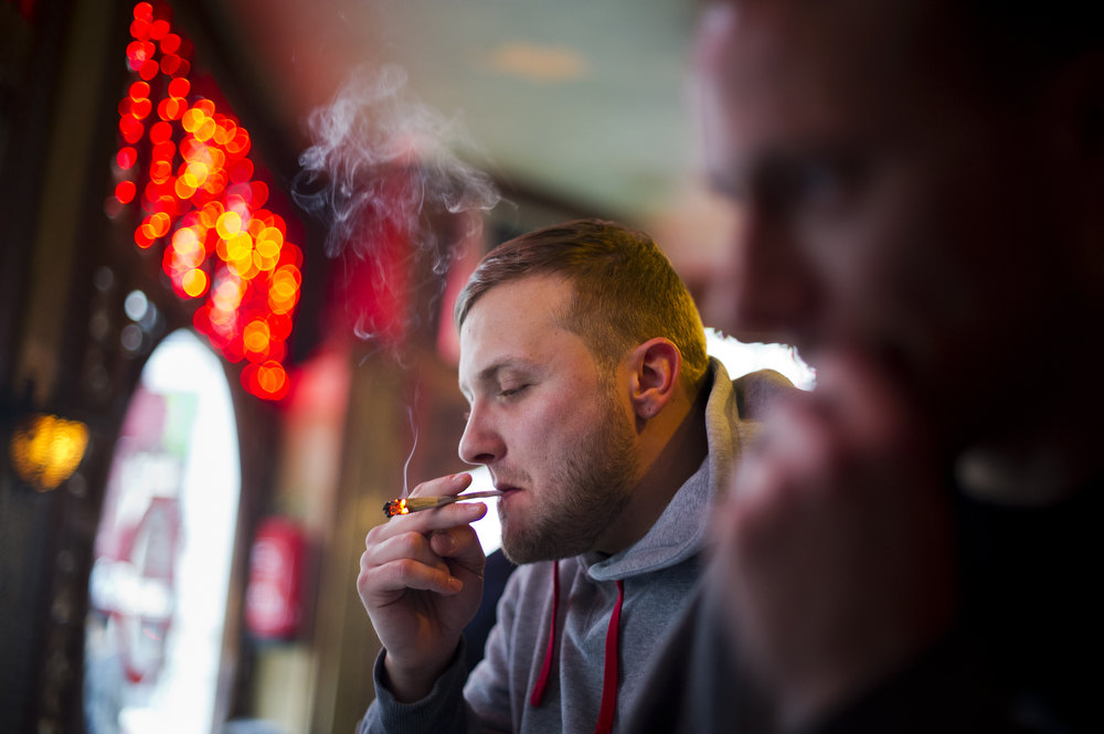 . Luke, 28 years old from London, smokes cannabis in a coffee shop on November 1, 2012 in the center of Amsterdam, Netherlands. Coffee shops in the Dutch captial will remain open to tourists after its mayor, Eberhard van der Laan, decided that tourists will not be banned from the 220 coffee shops in Amsterdam where marijuana and hashish are openly sold and consumed. The decision came after the new government of the Netherlands stated that it would be up to local authorities to decide whether or not to impose a ban on cannabis.  (Photo by Jasper Juinen/Getty Images)