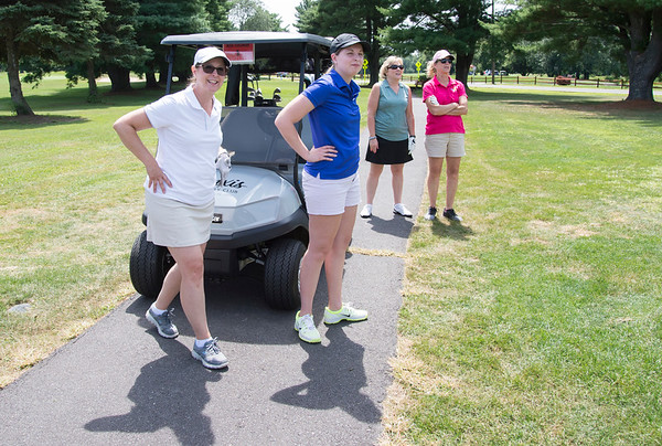08/05/19 Wesley Bunnell | Staff Dawn Nielsen, L, Katie Nielsen, Susan Sadecki, and Coral Richardson, look on as a fellow golfer in the women's 9 hole portion of the Bristol Chamber of Commerce's annual golf tournament tees off at Tunxis Country Club on Monday afternoon.