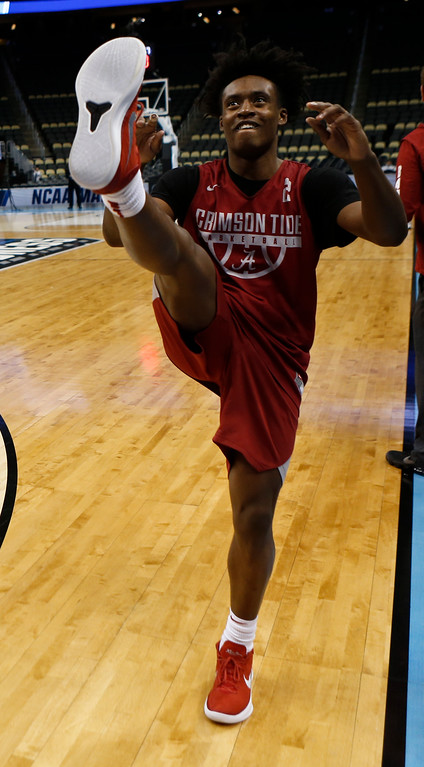 . Alabama\'s Collin Sexton (2) goes through stretching drills with the team during practice for an NCAA college basketball first round game in Pittsburgh, Wednesday, March 14, 2018. (AP Photo/Keith Srakocic)