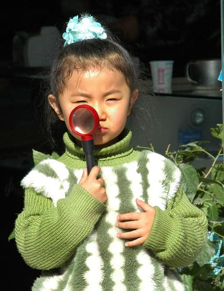Little Uighur Girl Playing Detective - Kashgar, China