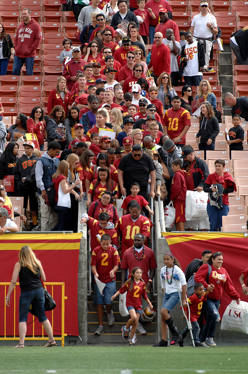 . Fans line up to get on the field for an autograph session following USC\'s Spring Football Game. (Michael Owen Baker/Staff Photographer)