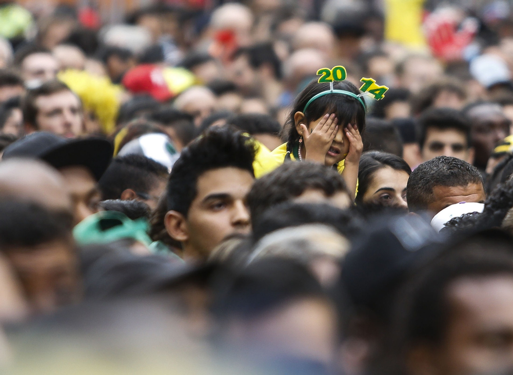Description of . A fan of Brazil gestures at the Fan Fest public viewing event in Sao Paulo, Brazil, for the start of the FIFA World Cup semi-final football match between Brazil and Germany on July 8, 2014. (Miguel Schincariol/AFP/Getty Images)