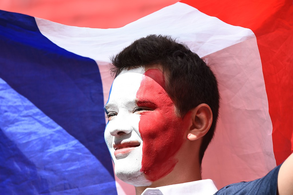 . A France fan cheers prior to a Round of 16 football match between France and Nigeria at Mane Garrincha National Stadium in Brasilia during the 2014 FIFA World Cup on June 30, 2014.       AFP PHOTO / JEWEL SAMAD/AFP/Getty Images