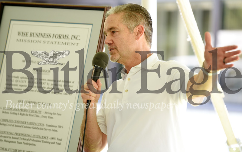 Harold Aughton/Butler Eagle: Executive Vice Presdent, Jeff Prettyman, of Wise Business Forms addresses employees, friends and vendors during the company's 50th Anniversary Monday, August 19. 2019.