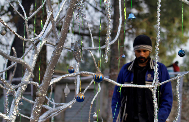 . A Pakistani Christian prepares a Christmas tree at an enclosure in preparation for Christmas in Islamabad\'s slums, Pakistan, Wednesday, Dec. 24, 2014. (AP Photo/Anjum Naveed)