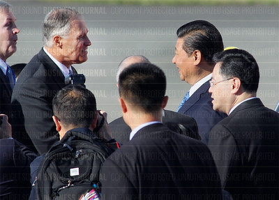 Chinese president Xi Jinping and his wife first lady Peng Liyuan arrive in the U.S. on a Boeing 747-400 jetliner after landing at Paine Field in Everett, Washington