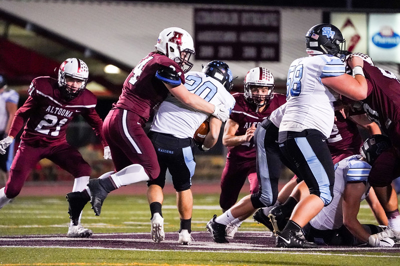 Altoona's #24 Hunter Stoudnour with a big defensive stop early in the game.  SV RB # 20 Noah Mancuso