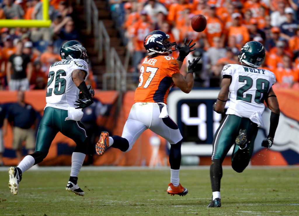 . Denver Broncos wide receiver Eric Decker (87) pulls in a pass from  quarterback Peyton Manning (18) for a catch and run during the second quarter, The Denver Broncos took on the Philadelphia Eagles at Sports Authority Field at Mile High in Denver on September 29, 2013. (Photo by Joe Amon/The Denver Post)