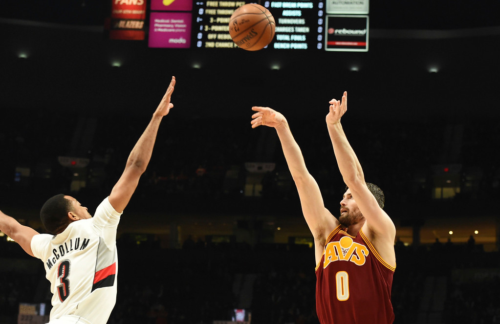 . Cleveland Cavaliers forward Kevin Love shoots the ball over Portland Trail Blazers guard C.J. McCollum during the first half of an NBA basketball game in Portland, Ore., Wednesday, January 11, 2017. (AP Photo/Steve Dykes)