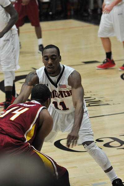 Isaiah Ivey defends against Winthrop University Tuesday February 19, 2013.