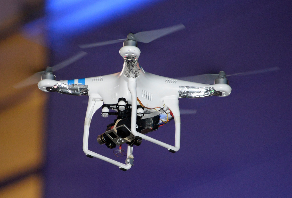 . A drone was taking photos outside Staples Center after the Kings won the Stanley Cup on June 13, but fans brought the small aircraft down. The drone started to fly low to get closer photos of the fans and was knocked out of the air when fans threw water bottles and other objects at it. A Kings rally towel hit the drone and it fell into the crowd and broke into pieces.  No one was hurt and it was unknown who took it or who was flying it. Photo by Gene Blevins/LA DailyNews