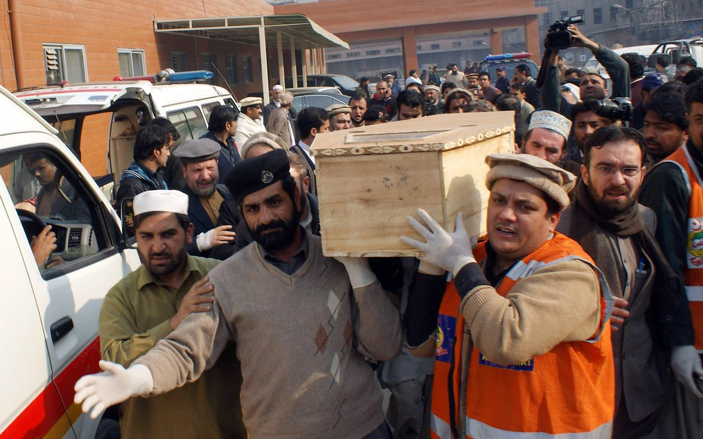 . Pakistani volunteers move the coffin of a student from a hospital following an attack by Taliban gunmen on a school in Peshawar on December 16, 2014. Taliban insurgents killed at least 130 people, most of them children, after storming an army-run school in Pakistan December 16 in one of the country\'s bloodiest attacks in recent years. AFP PHOTO/ A  Majeed/AFP/Getty Images