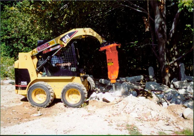 NPK E203 hydraulic hammer on Cat skid steer at NPKCE (1).JPG