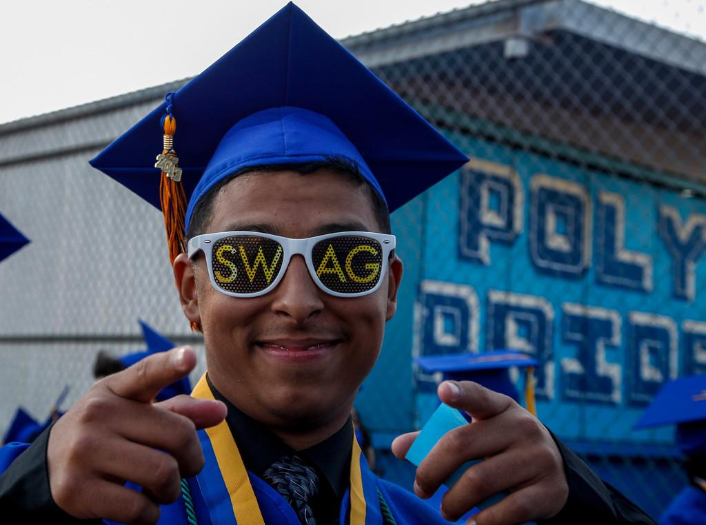 ". Graduate, Joe Hernandez shows off his \""SWAG\"", at John H Francis Polytechnic High School, Sun Valley, Calif., June 7, 2013. Photo: Lynn Levitt."
