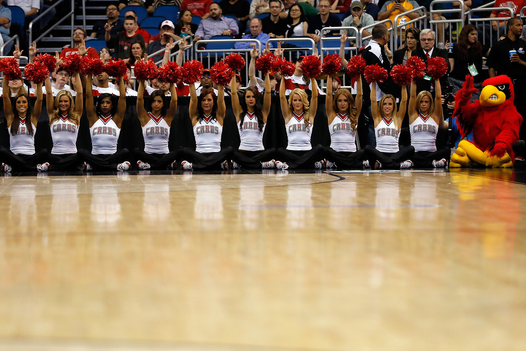 . The Louisville Cardinals cheerleaders perform during the second round of the 2014 NCAA Men\'s Basketball Tournament at Amway Center on March 20, 2014 in Orlando, Florida.  (Photo by Kevin C. Cox/Getty Images)