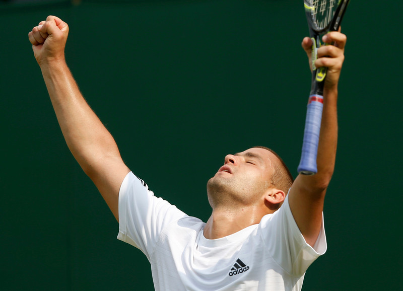 . Mikhail Youzhny of Russia celebrates after defeating Vasek Pospisil of Canada in their men\'s singles tennis match at the Wimbledon Tennis Championships, in London June 26, 2013.         REUTERS/Eddie Keogh