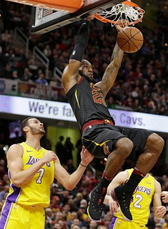 . Cleveland Cavaliers\' LeBron James (23) dunks against Los Angeles Lakers\' Larry Nance Jr. (7) in the first half of an NBA basketball game, Thursday, Dec. 14, 2017, in Cleveland. (AP Photo/Tony Dejak)