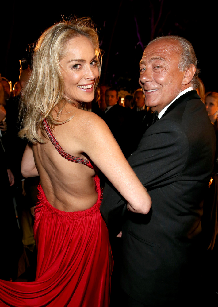 . Actress Sharon Stone and De Grisogono Founder and President Fawaz Gruosi attend the \'De Grisogono\' Party during The 66th Annual Cannes Film Festival at Hotel Du Cap Eden Roc on May 21, 2013 in Antibes, France.  (Photo by Andreas Rentz/Getty Images for de Grisogono)