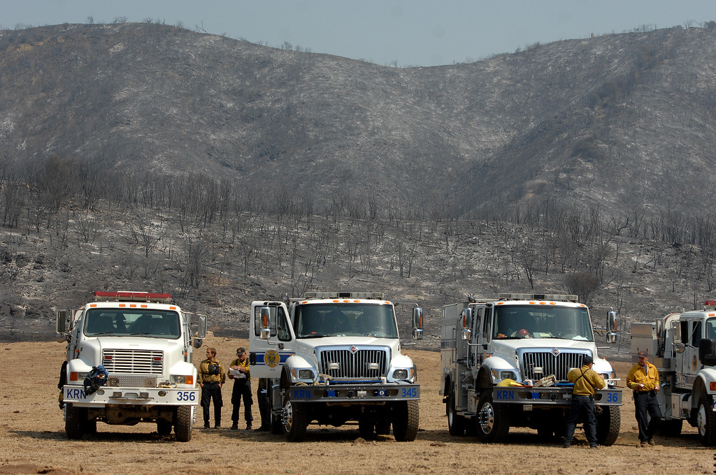 . Fire trucks stage by charred hills in Hidden Valley, Saturday, May 4, 2013. (Michael Owen Baker/Staff Photographer)