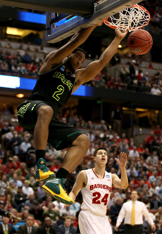 . Rico Gathers #2 of the Baylor Bears dunks the ball in front of Bronson Koenig #24 of the Wisconsin Badgers in the second half during the regional semifinal of the 2014 NCAA Men\'s Basketball Tournament at the Honda Center on March 27, 2014 in Anaheim, California.  (Photo by Jeff Gross/Getty Images)
