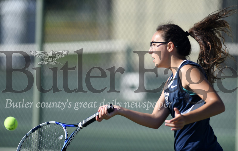 Harold Aughton/Butler Eagle: Butler's Aubrie Cavaliero returns a serve during the doubles match against Mars Monday, Sept. 9.