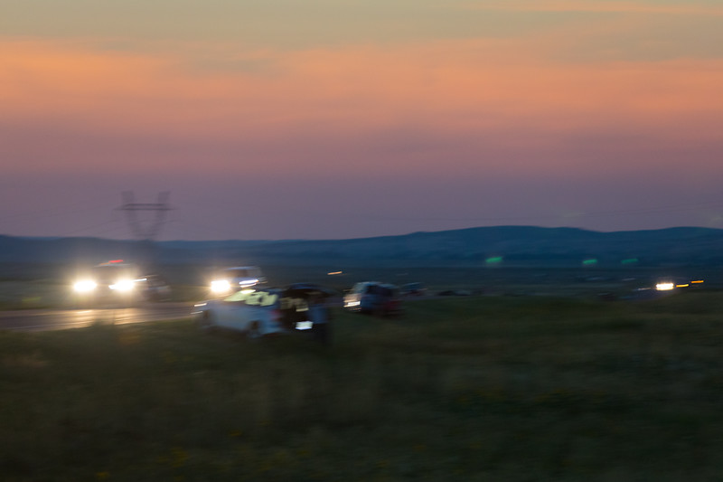Believe it or not, many people were leaving during totality.  It was so dark, they needed their headlights.  Strange to see them all trying to beat the traffic out DURING THE TOTALITY THEY CAME TO SEE.